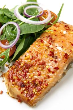 You can see in the photo how the salmon is topped with a minced chili, both the red part and the seeds. The seeds are the hottest part so le...