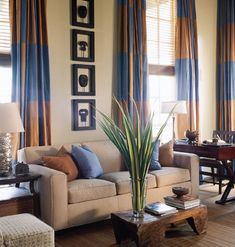 Striped drapes on windows in a den.