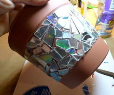 Bedazzle pots with old CDs. Craft for Elena and I to do with all of Ami's pots and my old CDs.