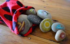 Story stones (acrylic paint on smooth flat stone). Foster storytelling and language development.