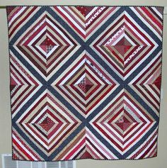Patriotic String Quilt by Norma Enfield.  From Norma: I'm the local leader of the nationwide group, Quilts of Valor Foundation. This is one of our favorite patterns for wounded veterans.