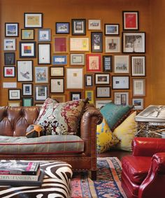 Like the medium brown sofa and red leather chair together with the zebra ottoman and mustard wall color.  I think all black frames, a zebra rug with a black, mustard or blue-green ottoman would be perfect.