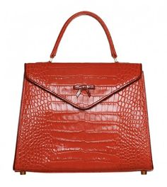 ELÈNE THE BELGIAN BAG from Hayden Lasher features lipstick red Italian crocodile embossed leather with cranberry patent piping, signature bow detail, and gold hardware.