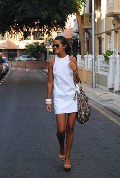 A tan, a white shift dress, nude heels, and a printed hobo...simple and fabulous!