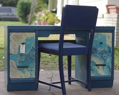 These draws are covered with national geographic maps of the ocean and on the top of the desk it's been painted with chalkboard paint, too fun.