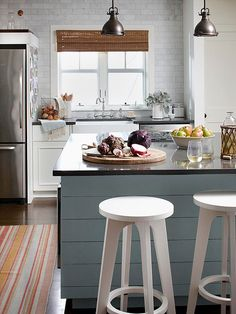 A cool blue island adds subtle color to this trendy kitchen. See more ideas for kitchen decorating: http://www.bhg.com/decorating/decorating-photos/kitchen/?socsrc=bhgpin042913blueisland