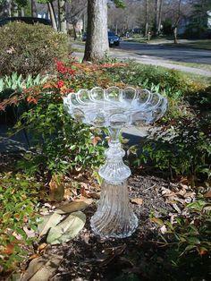 Upcycled glass bird bath.
