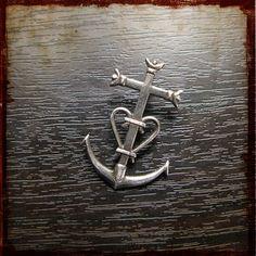 Camargue cross - symbolizes faith, hope and love.