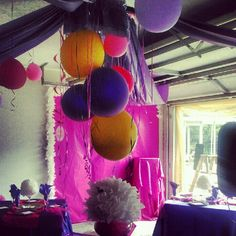 Try transforming your garage with a wrapping paper backdrop, cover your garage motor with a chandelier made with balloons, plastic table cloths and ribbons and more...