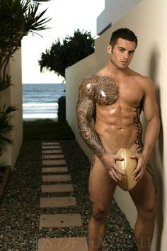 Daniel Conn. Retired rugby player.  Love the tats!