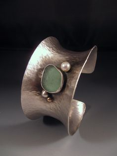 Anticlastic Cuff Bracelet by Emily Hickman.  Sterling silver, 14k gold, beach glass, and freshwater pearl.