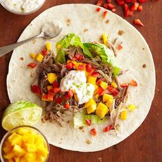 Slow-cooked Jamaican jerk pork is the base for these tasty wraps. Recipe: www.bhg.com/recipe/jerk-pork-wraps-with-lime-mayo-1/?socsrc=bhgpin092812jerkporkwraps