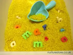 Take a sensory tub and hide some letters inside -we use our zingy lemon scented sensory tub with fridge magnet letters.