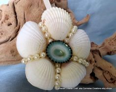 White shell floral ornament with turquoise limpet shell center