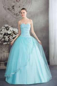 Stunning jeweled appliques detailed bodice tulle covered ball gown