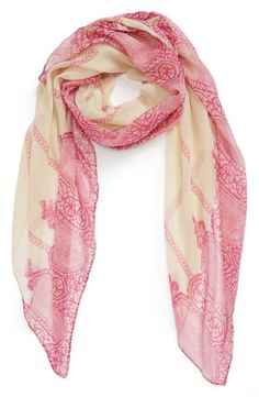 Pretty! Love the delicate lace print on this magenta and ivory scarf.