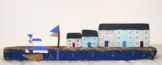 My little driftwood houses and sail boat