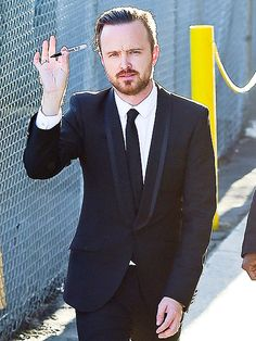 Have Sharpie, will autograph! Aaron Paul, who just nabbed his third Emmy Award, is prepared for fan requests outside L.A.'s El Capitan Theatre, where he stopped by Jimmy Kimmel Live on Thursday.