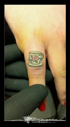 Cue little tea cup finger tattoo