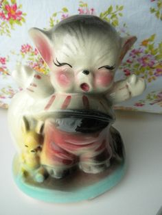 Vintage kitty and bunny figurine.