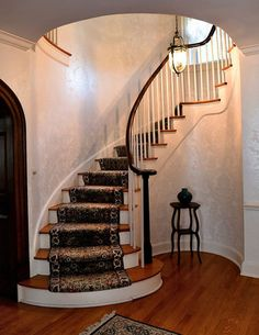 118 Wendell Terrace Syracuse, NY 13203. The circular stairs in the foyer.
