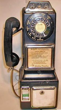 Old Rotary Pay Phone - Calls were 10 cents - My parents have one of these in an old phone booth in the basement of their house.  SO COOL!
