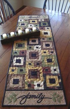 Would like nice in some bright/fresh colours - maybe a use for my Happy go lucky charm squares??? Primitive Folk Art Quilt Table Runner Pattern:  FAMILY TABLE RUNNER
