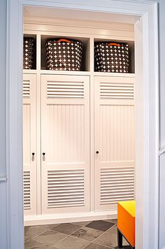 Locker style cubby doors for mudroom.
