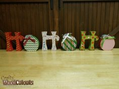 "Unfinished Ho Ho Ho Letter Set Wood Craft. This craft is about 37.5"" wide and 6.5"" tall and costs $21.59.  I'd love to win something like this!"