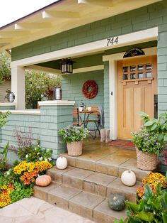 Use contrasting trim to make your wooden front door the focal point! More exterior door ideas: http://www.bhg.com/home-improvement/door/exterior/exterior-doors-and-landscaping/?socsrc=bhgpin091213woodentrydoor&page=11