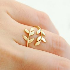 Gold double leaf wrap around ring. LOVE the delicate craftmanship. Would love to know the Designer.