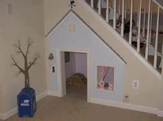 Indoor dog house.. perfection. If you have a closet under your stairs make it into a perfect resting and hiding place for your precious pooch. A room of his/her own. I think the window is painted on.