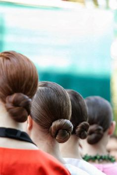 tight lady-like buns