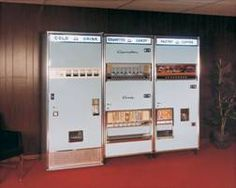 """A bank of 1960s vending machines serving """"Refreshments"""" including soup."""