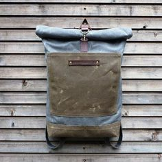 Waxed canvas rucksack/backpack with roll up top and double waxed bottom