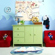 By the Sea - Two tones of blue create the feeling of the ocean in this child's room. A wave pattern is a fun take on more traditional wainscot.