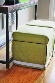 recovering cheap pleather storage ottomans via emily clark.  really why didn't I think of that?!