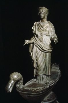 """""""The only surviving image of Sequana is a large bronze statue of a woman draped in a gown and with a diadem on Her head who stands on a boat, the prow of which was shaped like the head of a duck. This statue can now be seen in the Museé Archeologique de Dijon. Though duck lore is scarce in later Celtic writing it may be, by association with Sequana as a healing water Goddess that the duck was also associated with healing cults."""