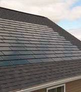 A house with a Solar Panel roof.