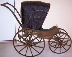 GREAT VICTORIAN BABY STROLLER ......LEATHER FOLDING TOP W/ WINDOWS & SPRING SUSPENSION .