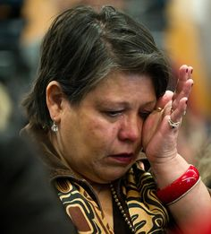 THE TRUTH HURTS: Residential school survivor Kim Good of the Snuneymuxw First Nation near Nanaimo, B.C. wipes away tears as she listens to Truth and Reconciliation Commission. She is not a mascot. She is a human being. Not a stereotype. She is a person w thought.  & the ability to shut you down. #idlenomore