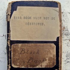 """Old """"Black Book"""" dating back to around 1900."""