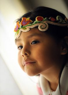 Melci Smith, 4-yo Crow Indian girl. Beaded headband, leather.