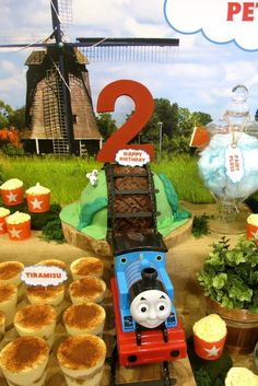Thomas Tank Engine dessert table for a birthday party via Kara's Party Ideas KarasPartyIdeas.com Cake, decor, printables, favors, recipes, tutorials, and more! #thomastrain #thomasthetankengine #thomastrainparty #trainparty (14)