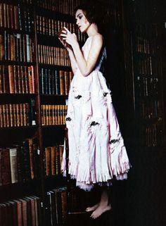 Keira Knightley reads.      Keira Knightley by Ellen Von Unwerth for Vogue Italia Jan. 2011
