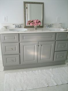 Gorgeous vanity purchased from Home Depot;  originally white, the homeowners gave it a couple coats of Martha Stewart's Cement Gray.  Love!