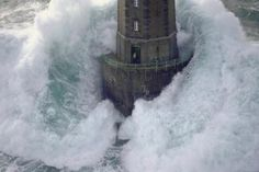 Lighthouse keeper and a huge wave