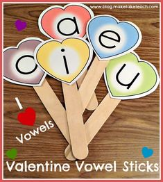 Make your own Valentine vowel sticks for use during small group instruction.  Free printable.