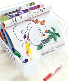 Using dish drying rack to organize coloring books and art supplies
