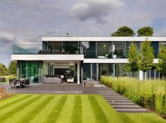 A Modern Country House On The Banks Of The River Thames by Gregory Phillips Architects